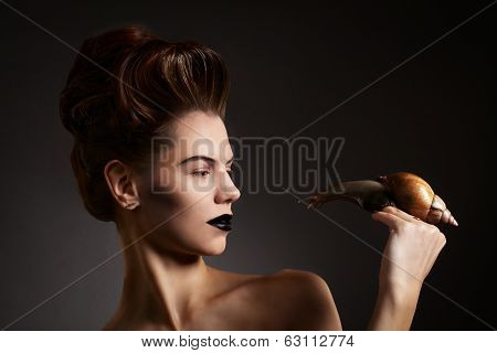 Beautiful Woman With Snail With Black Eyes And Lips. Fashion. Gothic