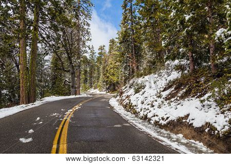 Road With Snow And Blue Sky