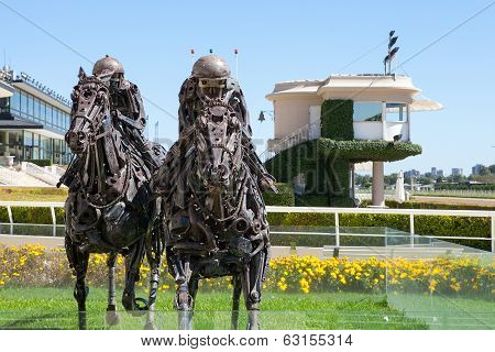 PALERMO RACECOURSE, BUENOS AIRES - MAR 13 2014 : Two racehorse sculptures await a new day's racing.