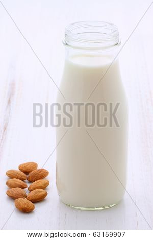 Delicious fresh almond milk on vintage styling. poster