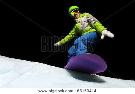 Young woman balancing with hands on snowboard