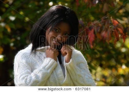 African-american Woman poses with white sweater