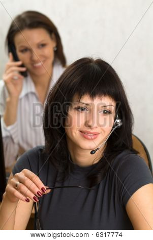Two Smiling Girls In An Office