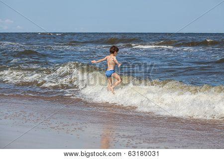 Boy Chasing A Waves