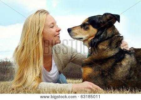 Woman Petting Her German Shepherd Dog Outside