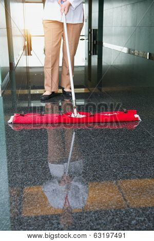 worker is cleaning the floor in an office building