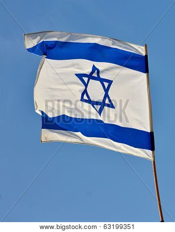 Israel flag in white and blue showing the Star of David hanging proudly for Israel's Independence Day (Yom Haatzmaut) poster