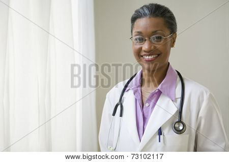 African American doctor standing and smiling
