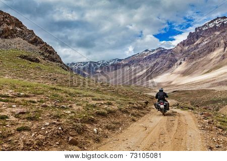 Bike on mountain road in Himalayas. Spiti Valley, Himachal Pradesh, India
