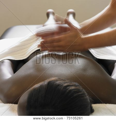 Young woman having a back massage