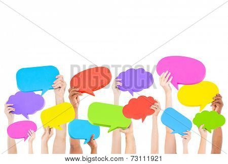 Hands holding speech bubbles.