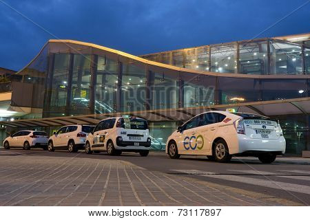 VALENCIA, SPAIN - SEPTEMBER 27, 2014: Taxi drivers waiting for passengers at the Valencia Airport in early morning. About 4.98 million passengers passed through the Valencia Airport in 2013.