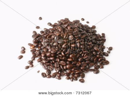 fresh roated coffee beans on white background