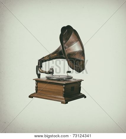 Photo of retro gramophone isolated over vintage stain background