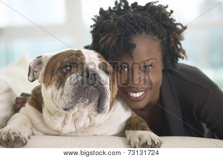 Young African woman smiling with British Bulldog