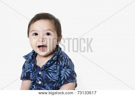 Studio shot of toddler boy smiling