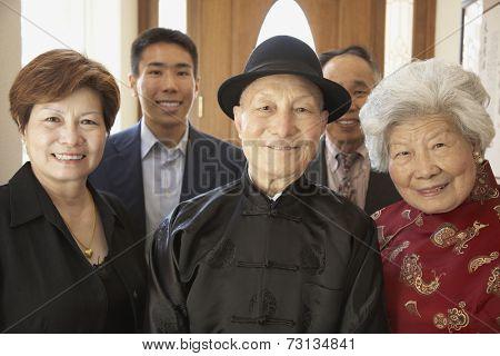 Multi-generational Asian family smiling