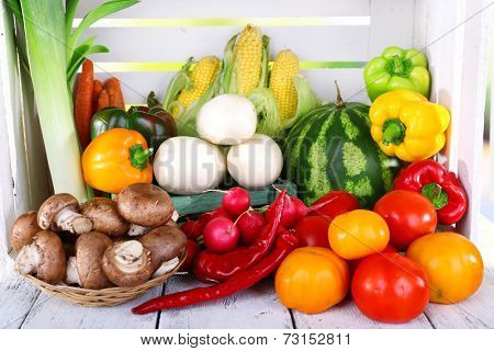 Vegetables on wooden table on white wooden box background
