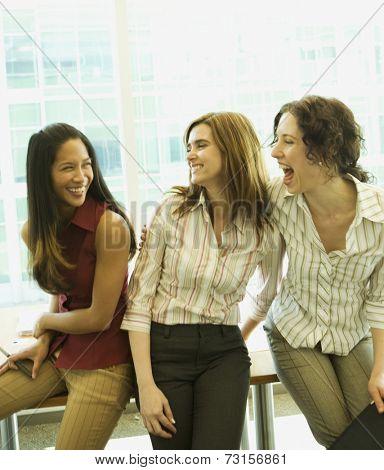 Multi-ethnic businesswomen laughing
