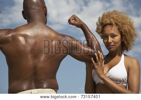 African man flexing for wife