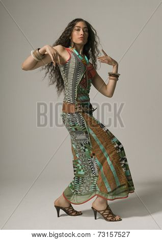 Studio shot of Asian woman dancing