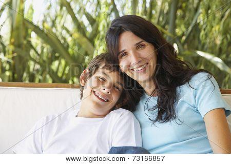 Hispanic mother and son hugging