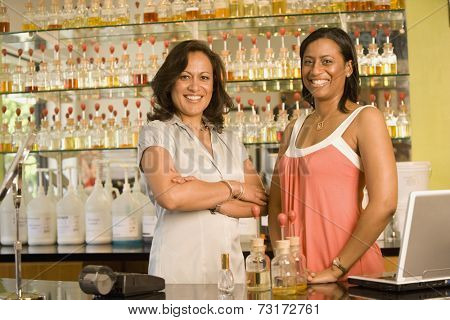 Multi-ethnic female sales clerks at perfume store