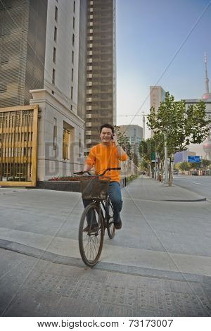 Asian man riding bicycle