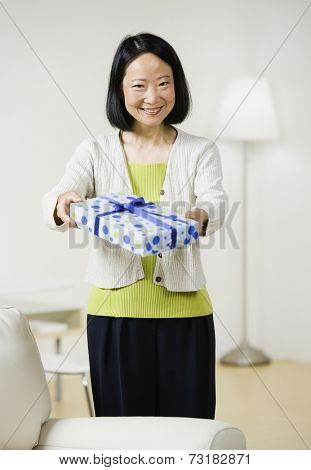 Asian woman holding gift