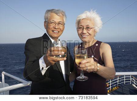 Senior Asian couple toasting
