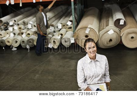 Native American sales representative in carpet warehouse