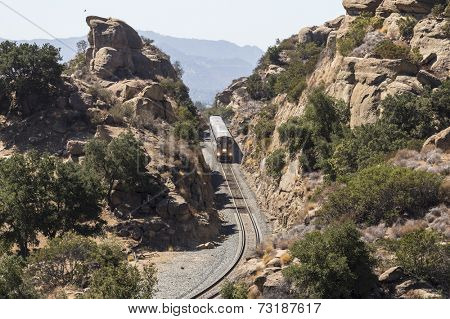 LOS ANGELES, CALIFORNIA - September 29, 2014:  Amtrak Surfliner train passing through the Santa Susana Pass on the edge of the city of Los Angeles.