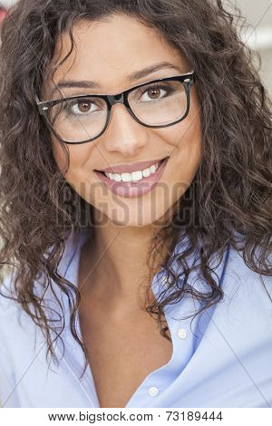 A beautiful intelligent mixed race Latina girl or young woman looking happy and wearing geek glasses