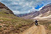 Bike on mountain road in Himalayas. Spiti Valley, Himachal Pradesh, India poster
