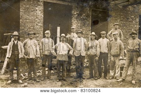 BERLIN, GERMANY, CIRCA 1930's: Vintage photo of group of workmen outdoor