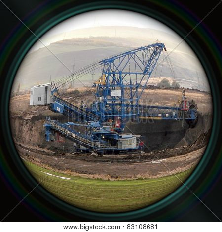 Excavator In Surface Coal Mine In Objective Lens