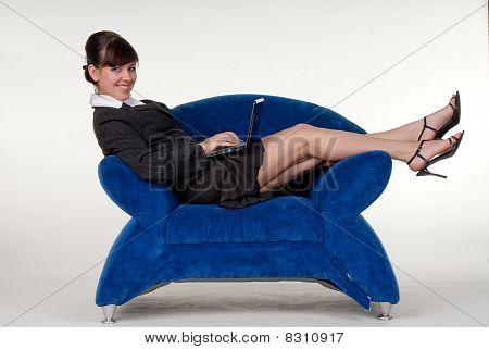 sexy secretary lying down with laptop