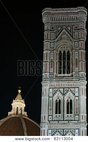Florence Italy: detail of Brunelleschi dome and Giotto Bell tower at night poster