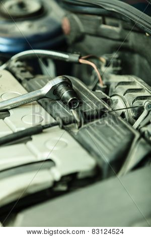 Auto repair shop. Car in service repairing. Closeup detail of engine assembly in automobile and tools. poster