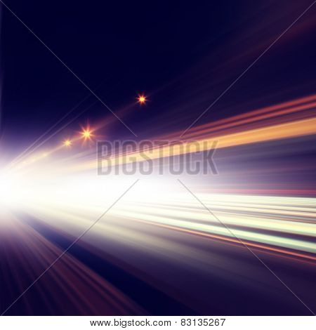Abstract image of traffic lights in the city at night.