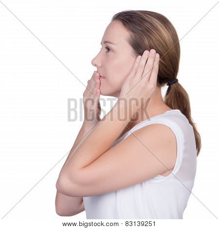 Woman With Hand Over One Ear And Hand Over Mouth