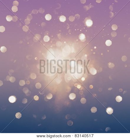 Abstract purple and blue bokeh glittering light effect