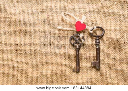 Two Vintage Key And A Red Heart On Old Cloth