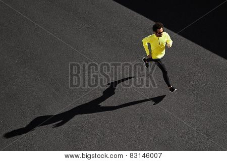 Running Man Sprinting For Success On Run. Top View Athlete Runner Training At Fast Speed At Black As