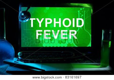 Computer with words Typhoid Fever.