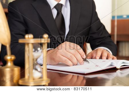 Businessman checking up a diary