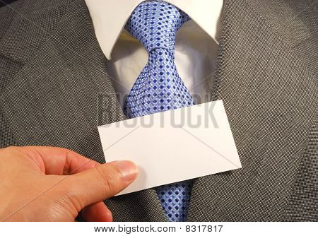 A business man showing a blank card concepts of filling your text here