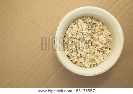 Small Wholemeal Oat Flakes In A White Porcelain Cup