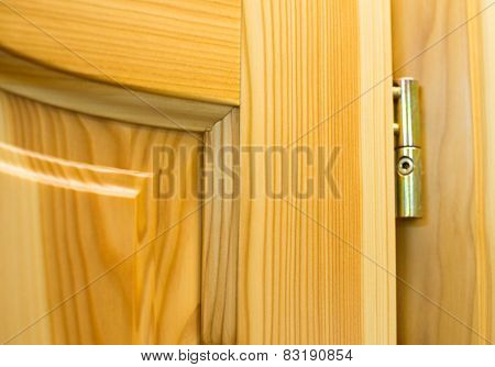 Golden Barrel Hinge On The Wooden Door