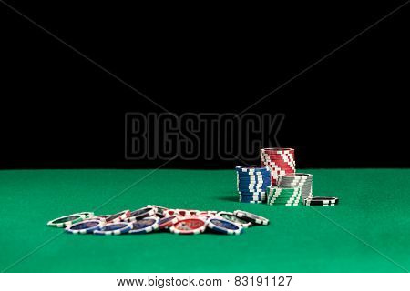 Colourful Poker Chips On Green Background